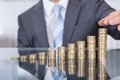 Businessperson With Stack Of Coins Royalty Free Stock Images - 43435099