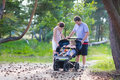 Young Family Hiking With Two Kids In A Stroller Stock Image - 43435541
