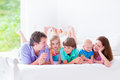 Happy Big Family In A Bed Royalty Free Stock Photo - 43435635