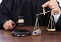 Judge Striking Gavel While Holding Scale With Money Stock Photography - 43446752