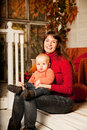 Beautiful Woman With A Child On The Front Porch With Pumpkins Au Royalty Free Stock Image - 43451026