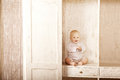 Beautiful Little Baby Sitting In The Closet. Smiling Child And I Stock Photos - 43454493
