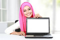 Attractive Asian Woman Showing Laptop Royalty Free Stock Image - 43475776