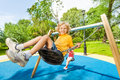 Boy Swings In Opposite Direction To The Girl Royalty Free Stock Photos - 43495598