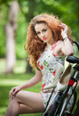 Beautiful Redhead Relaxing With Bicycle In The Summer Park Royalty Free Stock Photos - 43529128