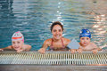 Mother And Children At The Swimming Pool Stock Photography - 43538452