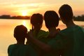 Family Near The River Against The Sunset Royalty Free Stock Photography - 43557857