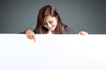 Asian Businesswoman Stand Behind A Blank Banner , Point Down And Stock Image - 43578071