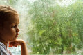 Girl Looking At Raindrops On The Window Stock Images - 43599654