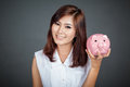 Beautiful Asian Girl With A Pink Pig Money Box Stock Images - 43614714