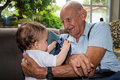 Baby Boy With Great Grandfather Stock Image - 43647761