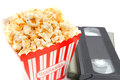 Popcorn In Box And Video Cassette Stock Photo - 43683500