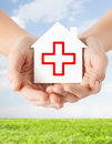 Hands Holding Paper House With Red Cross Royalty Free Stock Images - 43684009