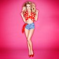 Cute Beautiful Blond Woman In Red Polka Dots Royalty Free Stock Photo - 43685385