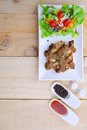 Grilled Steaks, Pork With Pepper Gravy And Vegetable Salad Stock Photography - 43690432