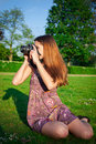 Girl With The Camera In The Park Stock Photography - 43709152