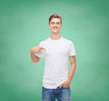 Smiling Young Man In Blank White T-shirt Royalty Free Stock Image - 43724196