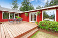 Bright Red House With Walkout Deck And Patio Area Royalty Free Stock Photography - 43730657