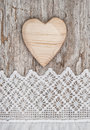 Wooden Heart On The Lace Fabric And Old Wood Stock Image - 43735971