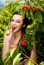Beautiful Young Woman Eats Cherry On Plantation Stock Photography - 43747592