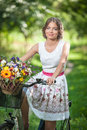 Beautiful Girl Wearing A Nice White Dress Having Fun In Park With Bicycle. Healthy Outdoor Lifestyle Concept. Vintage Scenery Stock Image - 43778031