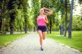 Healthy And Happy Woman Running In Urban Park With Headphones Stock Photo - 43783590