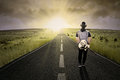 Lonely Guitarist Walking On Road Royalty Free Stock Photos - 43783888