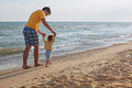 Father And Child Walking On The Beach Stock Photography - 43785182
