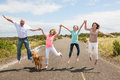 Family Jumping Together On The Road Royalty Free Stock Photos - 43787598