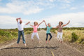 Family Jumping Together On The Road Royalty Free Stock Photo - 43787605