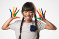 Little Asian Girl With Her Hands In The Paint Royalty Free Stock Images - 43791229