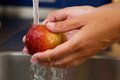 Female Hands Holding Apple Under Water Stock Image - 43803451