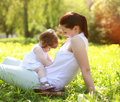 Mom And Baby Having Fun On Grass Royalty Free Stock Photography - 43806067