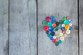 Vintage Buttons In The Shape Of A Heart On A Wooden Background Stock Photo - 43809640