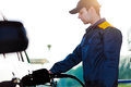 Gas Station Worker Refilling Car At Service Station Royalty Free Stock Images - 43814779