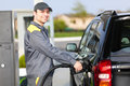 Gas Station Worker Refilling Car At Service Station Stock Photos - 43814823