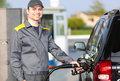 Gas Station Worker Refilling Car At Service Station Royalty Free Stock Photo - 43814835