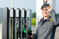 Gas Station Worker Refilling Car At Service Station Stock Images - 43814844