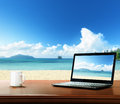 Notebook On Table And Beach Stock Photo - 43825740