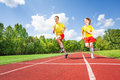Two Guys Running Together In Competition Royalty Free Stock Photo - 43847925