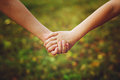 Close Up Of Children Holding His Hand In Summer Park Outdoor. Royalty Free Stock Photography - 43852347
