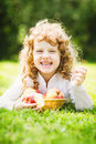 Child Is Eating Red Apple In The Summer Park. Stock Photography - 43852352
