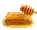 Wooden Dipper, Honey Drop And Honeycomb Royalty Free Stock Photo - 43852735
