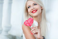 Young Sexy Blonde Woman With Heart Shaped Lollipop Royalty Free Stock Photography - 43858517
