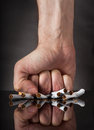 Man S Fist Crushing Cigarettes Royalty Free Stock Photography - 43866697