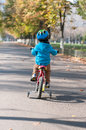 Young Boy Riding His Little Bicycle Stock Images - 43879014