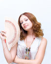 Girl Brush Away Face By Fan Royalty Free Stock Photography - 4390207