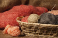 Multicolored Yarn Balls In A Straw Basket On The Sacking Stock Image - 43933041