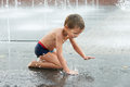 Happy Kid Playing In A Fountain Stock Photos - 43939693