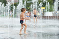 Happy Kid Playing In A Fountain Stock Photo - 43939870